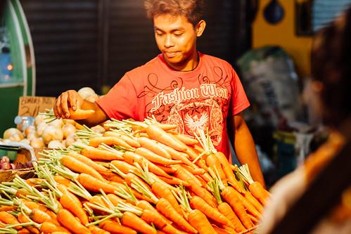 Carrot Vendor Arranging Wares, Philippines