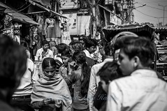 Extremely busy street... (Syahrel Azha Hashim) Tags: street travel light vacation portrait people bw india holiday detail 35mm prime blackwhite nikon cyclist dof market expression getaway tricycle indian streetphotography naturallight portraiture handheld shallow moment crowded streetmarket humaninterest olddelhi pc9 d300s syahrel