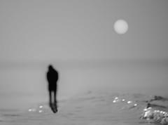 Solitude (Shams E Tabreez (Niloy)) Tags: sea sun man reflection silhouette twilight nikon solitude loneliness bangladesh outfocus coxsbazar 55200mm