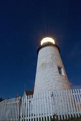 Shine (SunnyDazzled) Tags: longexposure nightphotography blue light sea sky lighthouse white tower station night fence stars point coast maine beacon shining starry beams pemaquid beaming