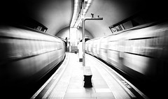 Clapham North Underground London by Simon & His Camera (Simon & His Camera) Tags: city urban blackandwhite bw white motion blur london monochrome train underground distorted tube trails tunnel indoor iconic simonandhiscamera