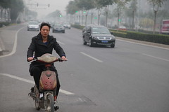 IMG_3781 Young Chinese woman driving dirty electric scooter in smoggy Beijing (Jordan Pouille JOURNALIST) Tags: china electric beijing scooter chine pkin