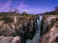 Epupa Falls (v-_-v) Tags: africa longexposure travel tree landscape rocks canyon na bluehour namibia angola epupa southernafrica kunene