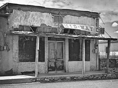 Mid-Way Cafe - Presidio,Texas (Rob Sneed) Tags: street wood food chihuahua hot southwest west brick abandoned sign rio clouds mexico vent cafe construction rocks closed texas crossing stones bordertown border rustic sidewalk porch slats intersection presidio ojinaga screendoors riogranderiver midwaycafe usmexicoborder presidiocounty usroute67 rioconchoriver texasfarmroad170