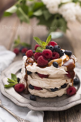 Caramel Pavlova Cake with fresh berries (vanilllaph) Tags: flowers red summer food cooking cake vertical fruit menu recipe table dessert cookbook leaf yummy berry colorful flavor sweet sauce rustic cream cook mint tasty fresh sugar gourmet delicious blueberry caramel homemade raspberry syrup custard treat organic portion ornate pavlova raspberries serving meringue culinary blueberries artisan topping whipped