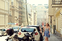 He watched her walk by everyday and littled did he know... (catarinae) Tags: vienna street city woman cars sterreich exploring young sunny blonde motorcycle austrian