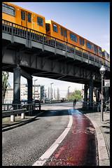 Elevated train / railway (Krueger_Martin) Tags: street city blue urban berlin rain yellow train kreuzberg colorful railway zug gelb stadt ubahn u1 40mm blau farbig hdr regen bunt elevatedtrain hochbahn photomatix strase festbrennweite primelense canoneos5dmarkii canoneos5dmark2 canonef40mmf28stm