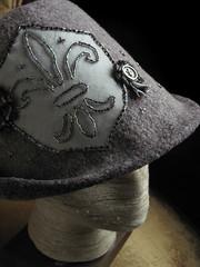 Fleur de Lis Cadet, detail (chronographia) Tags: wool hat grey beads silk felt fleurdelis millinery filthylucre exoticshadesofgrey treebarkgrey strangehoursatelier curiousmillinery