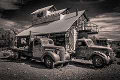 Two Trucks (King Grecko) Tags: usa history classic texture chevrolet abandoned car sepia contrast truck canon vintage emblem desert nevada rusty nelson pickuptruck retro chevy chrome vehicle ghosttown americana derelict chevvy gmc lightroom motoring motorcar 2470f28 5dmk3