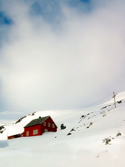 The Little Red House (Sabrina Chevallier Photography) Tags: travel blue winter red sky house mountain snow oslo norway train canon landscape cabin redhouse adventure bergen snowymountains trainride landscapephotography landscapephotographer canadiantraveller