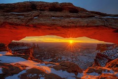 Mesa Arch Sunrise (Joe Y Jiang) Tags: park christmas trip travel winter sunset arizona usa sun snow southwest west nature beautiful clouds sunrise river wonder landscape dawn utah nikon sandstone colorado open dusk tranquility arches landmark newyear canyon formation national american valley page canyonlands antelope bryce zion horseshoe wilderness navajo capitolreef plato fourcorners momument calmness vast 2015 d800e