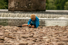 Fascination (dolbinator1000) Tags: park bridge boy summer water childhood stone wales person concentration child stones national blond stony fascination brecon beacons childish powys concentrate crickhowell