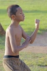 backlit Hawaiian boy (Pejasar) Tags: light boy shirtless sun male beach backlight hawaii dance child waikiki oahu honolulu