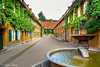 Fuggerei, Augsburg, Germany (Anke Schulz Jacobs) Tags: building green history water fountain yellow museum germany bayern deutschland bavaria wasser brunnen gelb grün gebäude augsburg fuggerei geschichte fugger