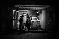 A conversation at the bakery (heshaaam) Tags: street bw night bahrain baker muharraq allhidd