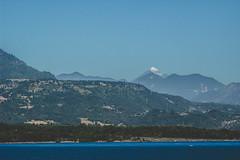 Cordilleras lejanas (cmenesese) Tags: chile travel lake nature landscape volcano ray scene villarrica lican