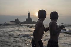 Brothers (Ravikanth K) Tags: sea people india beach boys water statue rock kids sunrise memorial brothers outdoor watching tourists cape kanyakumari thiruvalluvar vivekananda comorin southerntip 500px vivekanandarockmemorial taminladu
