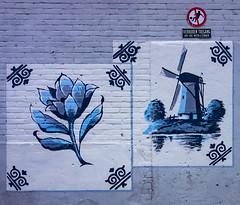 Fragile wall (Jorden Esser) Tags: flower windmill sign wall mural delft tiles brickwall porcelain delftblue hww deporceleynefles royaldelft nederlandvandaag wallwednesday earthenwarefactory nosoccerallowed