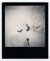 Self-portrait (Porcelain Veins) Tags: portrait blackandwhite selfportrait film analog self nude polaroid back key hand antique gothic goth nails 600 analogue emotional nailpolish emotive impossible nailvarnish artisticnude skeletonkey whitehair blackframe impossibleproject