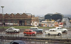 Moor Street Station, Birmingham, 1967 (Lady Wulfrun) Tags: birmingham moorstreetstation 7th april 1967 lotus cortina mk1 mk2 jaguar austin mini car cars 1960 rain br freightliner ad advert premiumbonds morrisminor 1000 scammelltownsman daimler 25 litre
