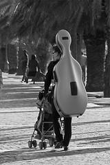 street00743 (cesare1942) Tags: street humour dietro carrozzini violoncelli