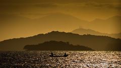 Calor (Diego S. Mondini) Tags: sunset sea brazil silhouette brasil bay boat mar santacatarina baía sãofranciscodosul silhueta babitonga baíadababitonga