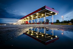 Reflected Truck Stop (Notley) Tags: light storm reflection water night clouds puddle evening spring midwest diesel gasstation reflect missouri april trucks bluehour midway canopy nocturne stormysky petrolstation 2016 10thavenue semitrucks notley ruralphotography boonecountymissouri ruralusa notleyhawkins midwaytruckstop dieselstation missouriphotography httpwwwnotleyhawkinscom notleyhawkinsphotography midwaytravelcenter midwaymissouri