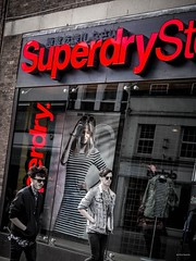 Supercool Guys (Silver Machine) Tags: street window boys sunglasses walking lumix outdoor candid streetphotography windsor shopwindow windowdisplay berkshire lumixg superdrystore lumixg20mmf17 lumixg5