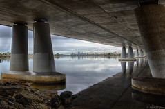 Framed city skyline (Ralph Green) Tags: bridge rain clouds reflections australia perth pylons westernaustralia hdr cityskyline perthskyline canningriver mounthenrybridge hdreffectspro2