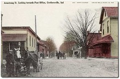 Armstrong Street looking towards the Post Office, Crothersville, Indiana (Hoosier Recollections) Tags: horses people usa man color men buildings clothing workmen mail postoffice indiana streetscene porch shops pedestrians storefronts grocery buggy buggies businesses wagons lampposts crothersville