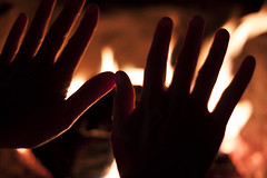 Cold hands, warm hearts (bbvdi7) Tags: wood hot cold canon outside fire warm bokeh warmth burning sparks