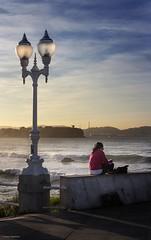 Mujer leyendo frente al mar, Gijon 2015 (Irene Ziel Photography) Tags: sea sky espaa costa muro sol canon atardecer eos mar mujer farola asturias paisaje cielo litoral gijon elogio norte lectura airelibre leyendo cantabrico actividad 100d