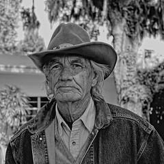 "Florida ""Cracker"" (John Ilko) Tags: man monochrome blackwhite cowboy florida fujifilm fl rancher palmetto 35mmf14 manateecounty floridacracker manateefair"
