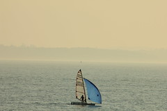 Alone at sea (My_adventure) Tags: sea seascape beach canon landscape photography boat alone hampshire minimal rig sail ambient dslr minimalist windsurf gosport gilkicker windsail