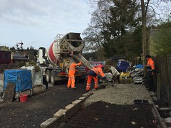 Concrete mixer unloads into shed base with Pike and Andrew 29Feb16