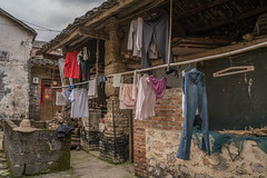 laundry.jpg (Photos4Health) Tags: china travel sunset shadow guy ecology sunrise dark li asia village place guilin yangshuo hill chinese elderly fisher stick tradition guizhou villager guangxi ecotourism xingping