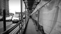 parallel universes (vfrgk) Tags: people blackandwhite bw cars monochrome buildings constructionarea walking movement chaos traffic duo perspective streetphotography tranquility tunnel streetscene structure urbanmoment littlepeople everydaylife streetview urbanlandscape urbanfragment streetfragment