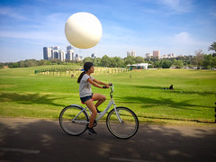big Time in a Small Town (amira_a) Tags: park grass bike spring afternoon ride balloon streetphotography tlv iphone