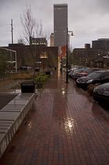 near the center of the universe (Pejasar) Tags: city morning light reflection brick oklahoma wet rain easter early downtown cityscape tulsa lightpost sidewalks centeroftheuniverse guthriegreen
