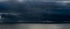 Storm over the ocean (Igor Sorokin) Tags: ocean travel sea panorama seascape storm reflection rain weather clouds landscape nikon pacific zoom horizon scenic dramatic atlantic telephoto nikkor dslr thunder severe waterscape 18300 d5300 flickrtravelaward