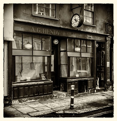 AG Hendy Shop in Hastings (TD2112) Tags: blackandwhite clock shop retail sepia canon vintage sussex victorian hastings dickens oldtown canon700d