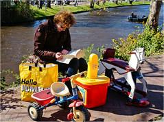 Playground (Hindrik S) Tags: street horse woman water bike wheel yellow bag toys reading book canal boek day candid sony streetphotography kings tamron vrouw rockinghorse leeuwarden straat hobbelpaard speelgoed a57 2015 lezen liwwadden frou ljouwert sunnyweather straatfotografie koningsdag tamron1750 sonyalpha tamronspaf1750mmf28xrdiiildasphericalif lze sonyphotographing boartersguod strjitte kh2018 slta57 57 hobbelhynder