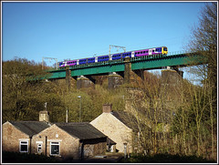 Northern 323, Dinting Viaduct (Jason 87030) Tags: camera uk greatbritain blue houses england sky electric architecture train flickr view purple shot unitedkingdom picture sunny scene viaduct fave views april emu alpha northern amateur railways bizarre glossop unit 323 2016 ilce electricmultipleunit dinting sonya6000