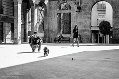 Playing in the square (Luis Alvarez Marra) Tags: street city bw dog white black 35mm square lens prime spain nikon flickr shadows outdoor candid creative commons snap catalonia crop soul luis moment alvarez collecting reus decisive marra d7000 streettog