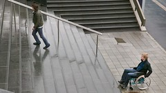 IS647-021 (discoveringability) Tags: man male walking outdoors trapped sitting wheelchair stairway using sidewalk youngadult twopeople challenge youngman contemplation ignorance disability accessibility caucasianethnicity onlymale discoveringability