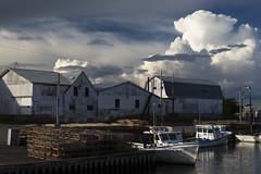 Down at the Dock (Elizabeth Stanton) Tags: canada port boats coast fishing dock tide bluesky atlantic coastline princeedwardisland fishingboats tidal pei waterside eastcoast fishingnets dockside murrayharbour