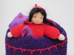 Sewed this small doll (just 5 inches), knitted her a hat, felted her a bed and embroidered her a blanket. She keeps me smiling all day! (ompompali Claudia) Tags: felted doll dollsbed