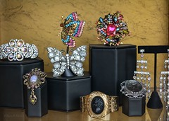 Vintage On Display (Little Hand Images) Tags: bracelet earrings jewels rhinestones brooches movieprops vintagejewelry butterflybrooch carvedrelief rhinestonebutterfly jewelrydisplaywindow