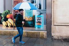 Bristol; January 2016 (Daniel Durrans) Tags: street blue urban food rain umbrella bristol walking shoes streetphotography banana bakedbeans heinz fusilli