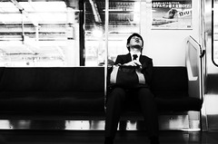 Monday Mood II (nzkphotography) Tags: travel sleeping blackandwhite streets guy monochrome japan underground subway japanese tokyo asia noiretblanc metro 28mm streetphotography highcontrast monday ricohgr compact 2015 seriouscompacts